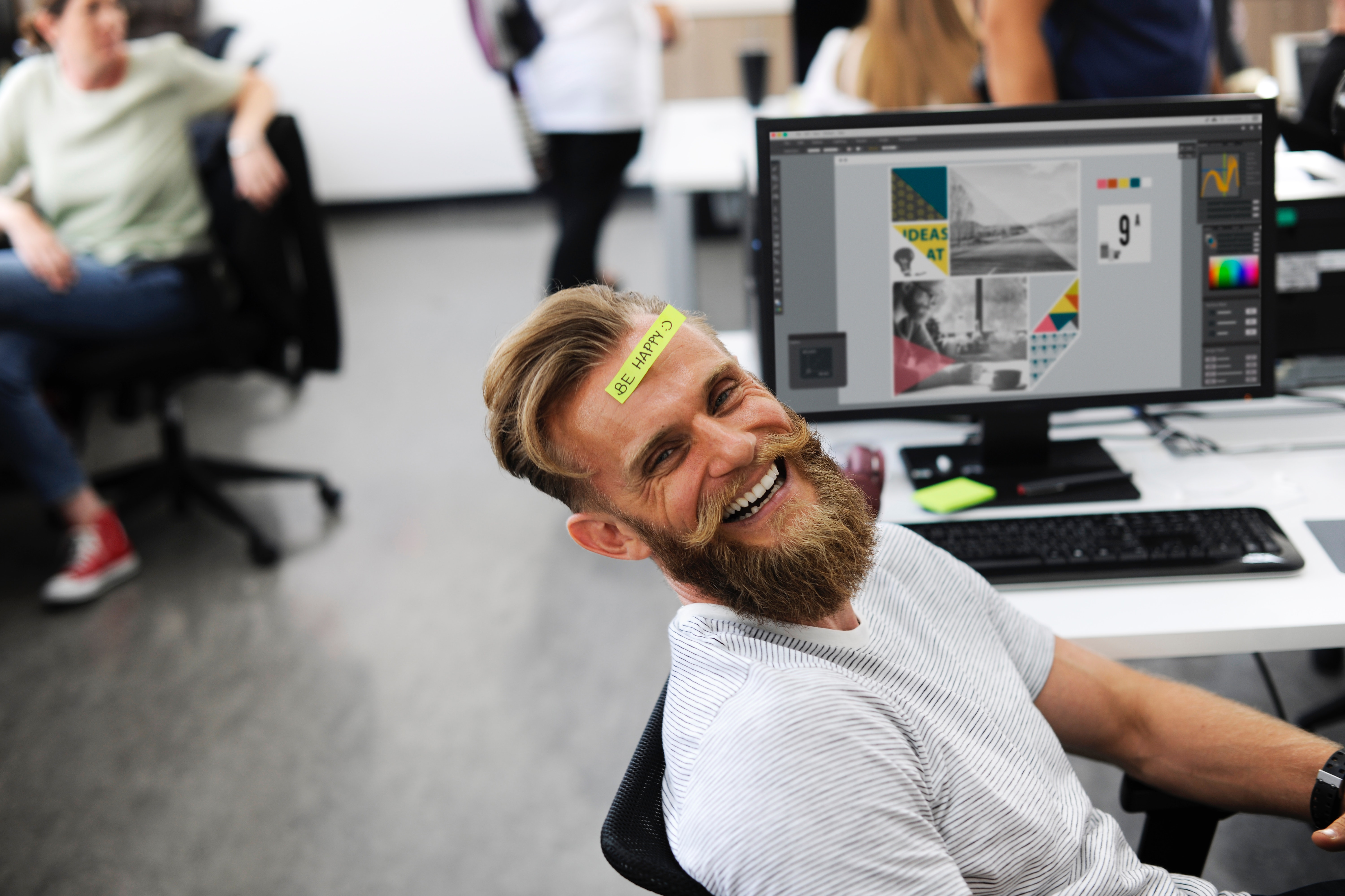 man is happy at work: positive reinforcement